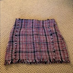 Never worn plaid fringe skirt.